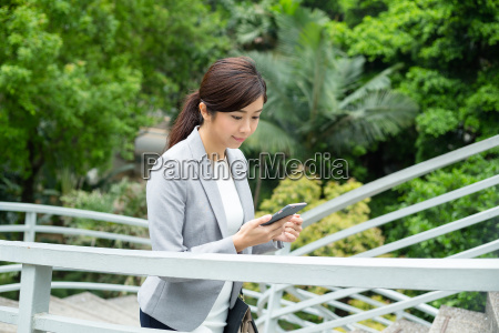 business, woman, looking, at, cellphone, and - 20116051