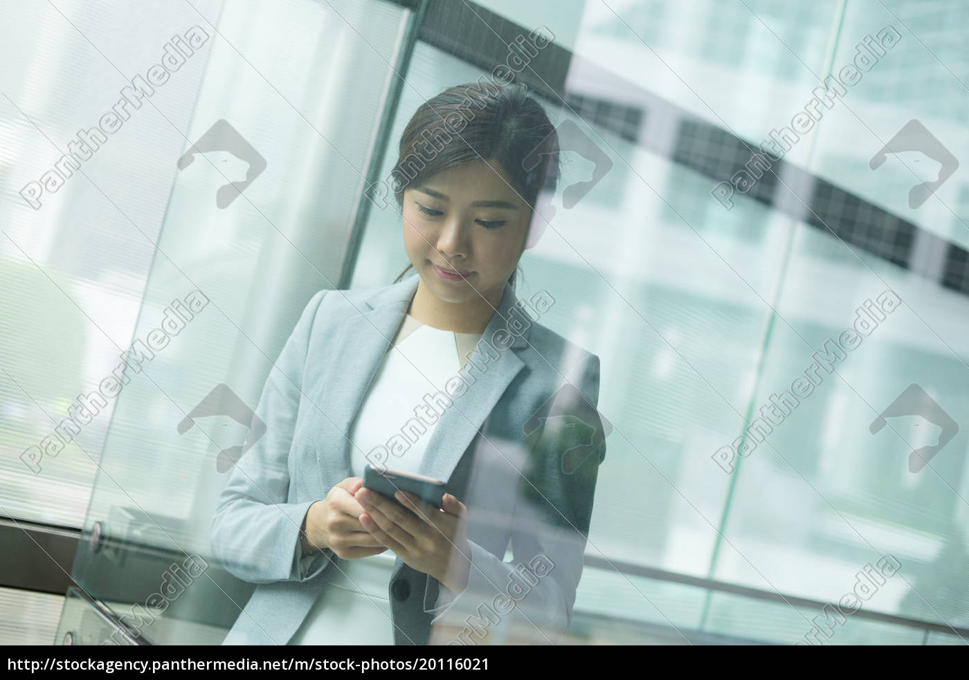 businesswoman, checking, her, cellphone - 20116021