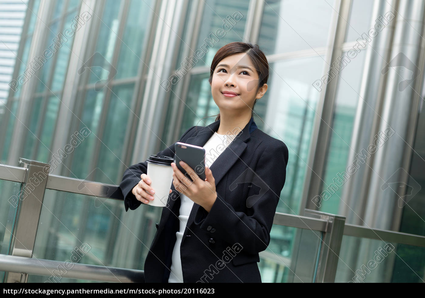 businesswoman, holding, coffee, cup, and, cellphone - 20116023