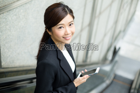 businesswoman, use, of, mobile, phone - 20116161
