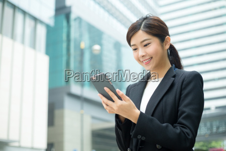 businesswoman, use, of, mobile, phone - 20116319