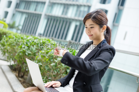 businesswoman, use, of, notebook, computer, and - 20116135
