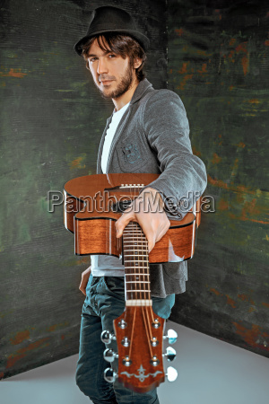 cool, guy, standing, with, guitar, on - 20116005