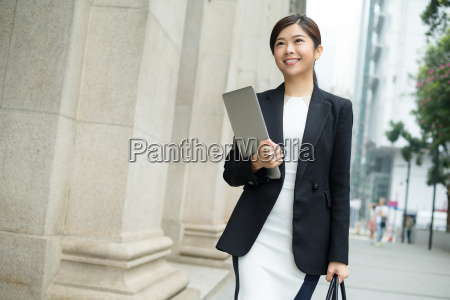 young, businesswoman, holding, laptop, computer, and - 20116273