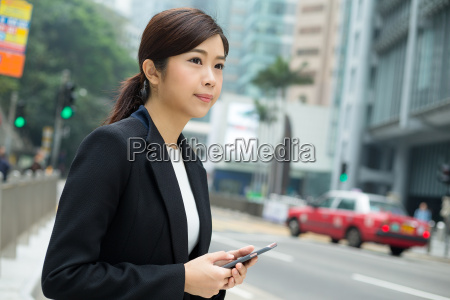 young, businesswoman, standing, at, outdoor - 20116237