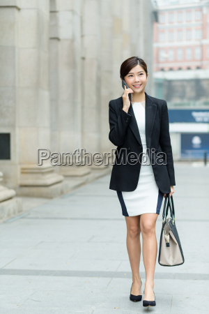 young, businesswoman, talk, to, cellphone - 20116275
