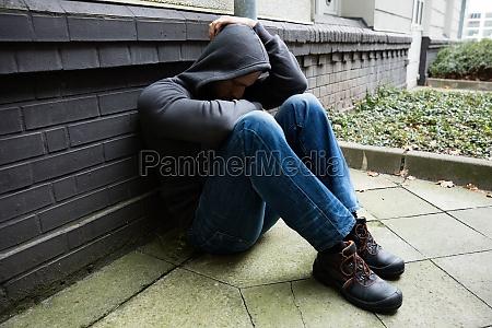 worried man sitting alone
