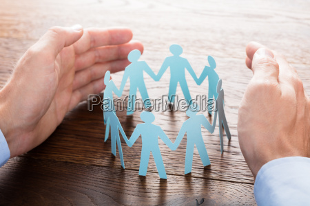 businessperson, protecting, cut-out, figures - 20117973