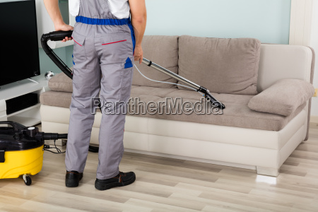 male, worker, cleaning, sofa, with, vacuum - 20117925