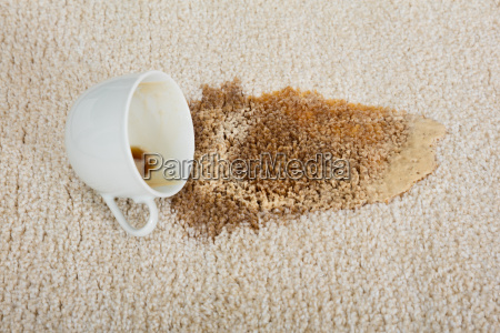 coffee, spilling, from, cup, on, carpet - 20118029