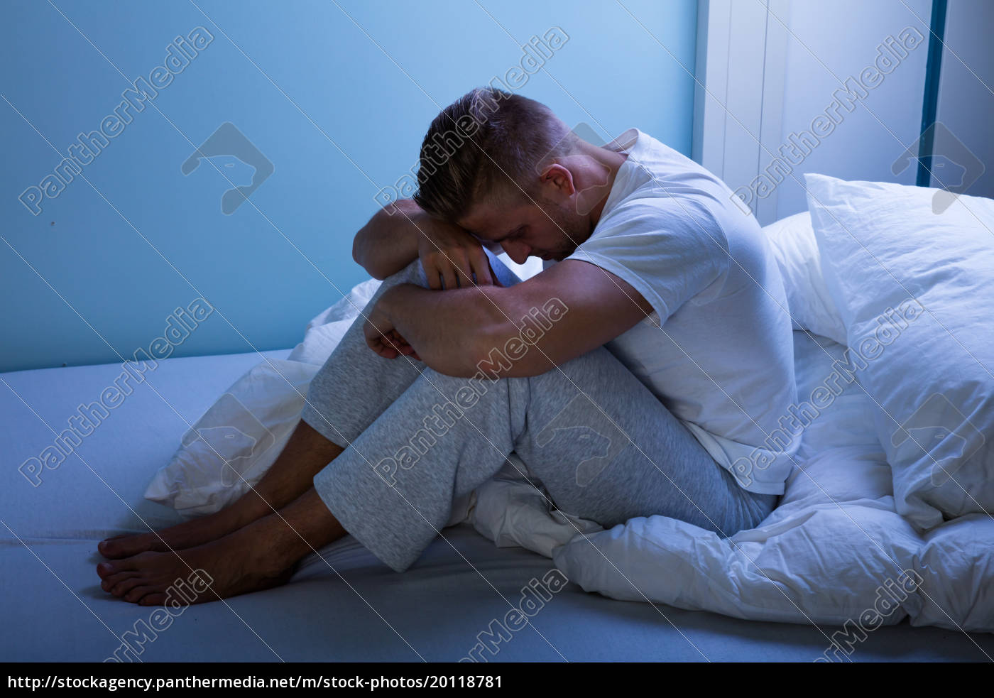 sad, man, sitting, on, bed - 20118781