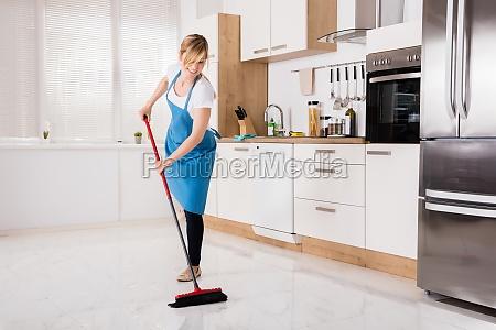 housemaid, sweeping, floor, in, kitchen - 20119521