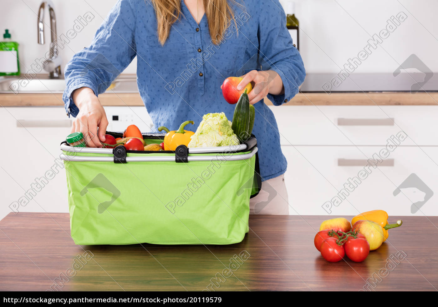woman, removing, vegetable, from, grocery, bag - 20119579