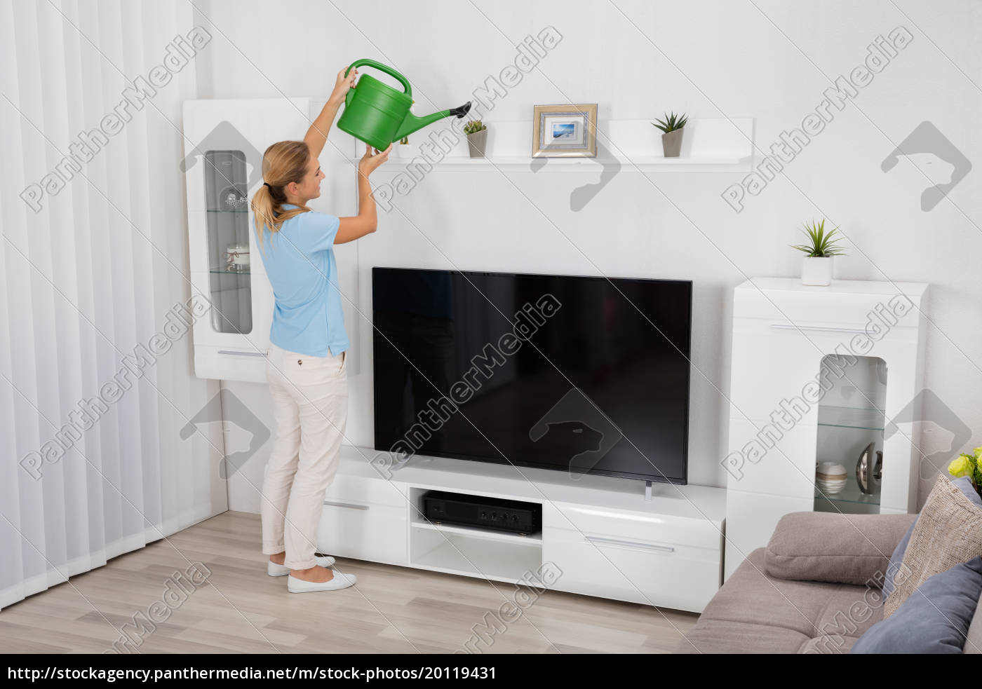 woman, watering, plant, at, home - 20119431