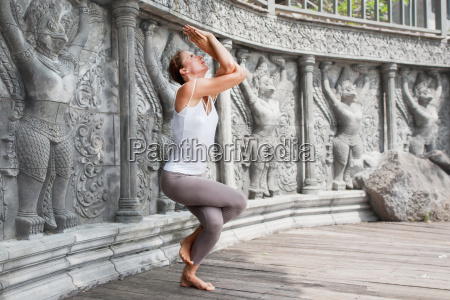 young, woman, doing, yoga, in, abandoned - 20120035
