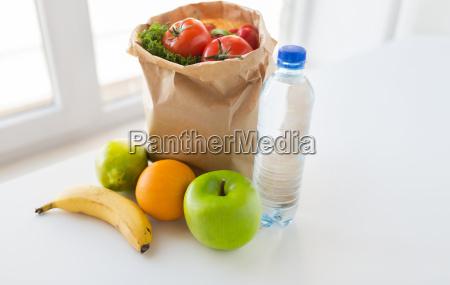 basket of vegetable food and water