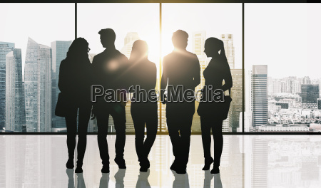 people silhouettes over window and city