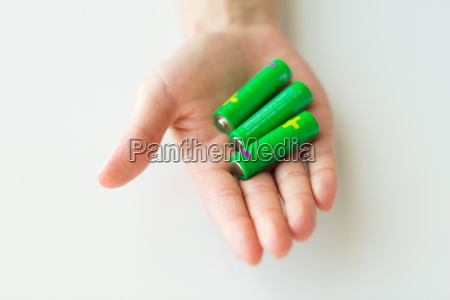 close up of hand holding green
