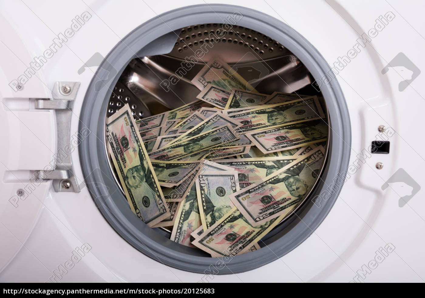 pile, of, money, in, washing, machine - 20125683