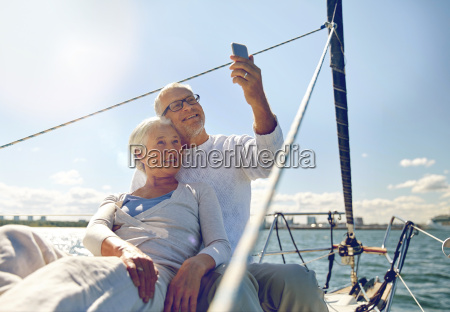 senior couple taking selfie by smartphone