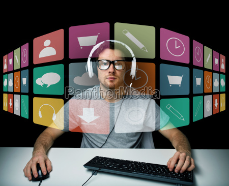 man in headset with computer and