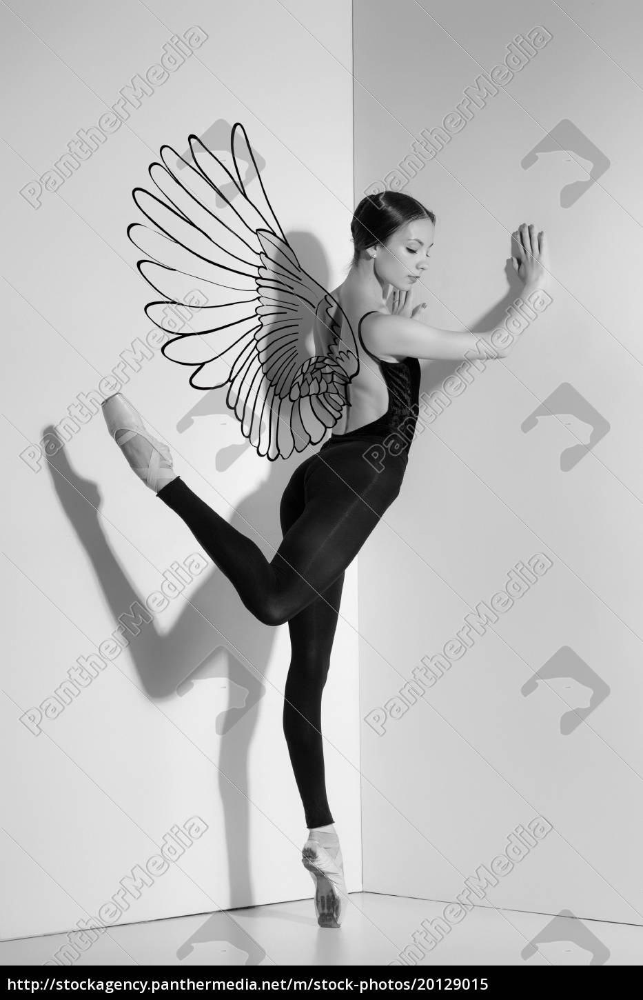 ballerina, in, black, outfit, posing, on - 20129015