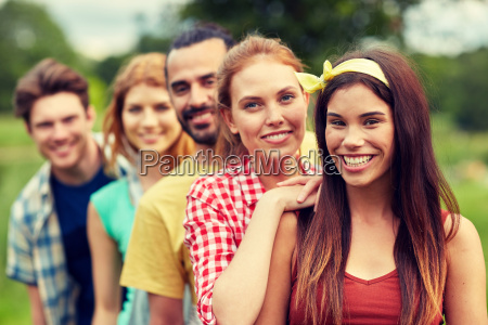 group of smiling friends outdoors