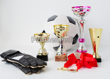 close up of football gloves cups