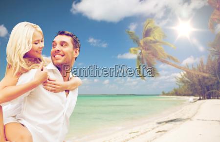 happy couple having fun over summer