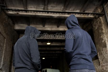 addict men or criminals in hoodies