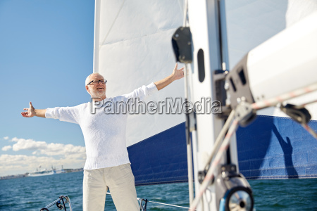 senior man on sail boat or