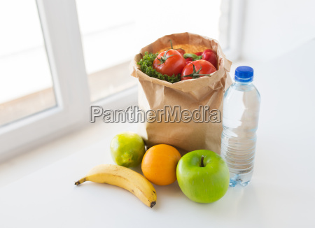 basket of vegetable food and water