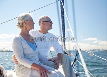 senior couple hugging on sail boat