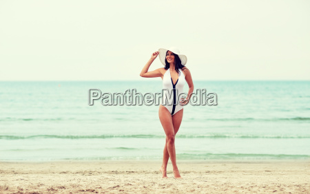 young woman in swimsuit posing on