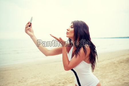 young, woman, taking, selfie, with, smartphone - 20150053