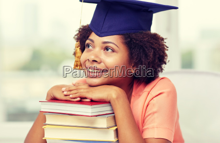 happy, african, bachelor, girl, with, books - 20151037