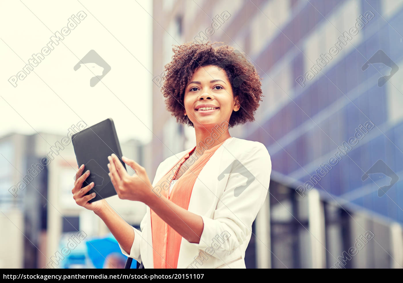 happy, african, businesswoman, with, tablet, pc - 20151107