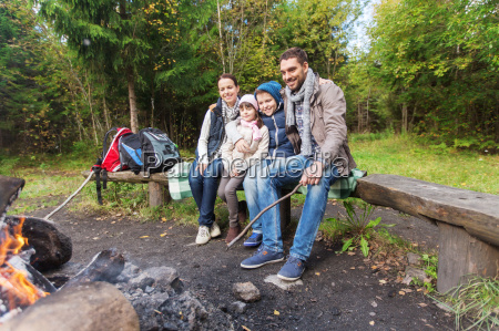 happy, family, sitting, on, bench, at - 20152783
