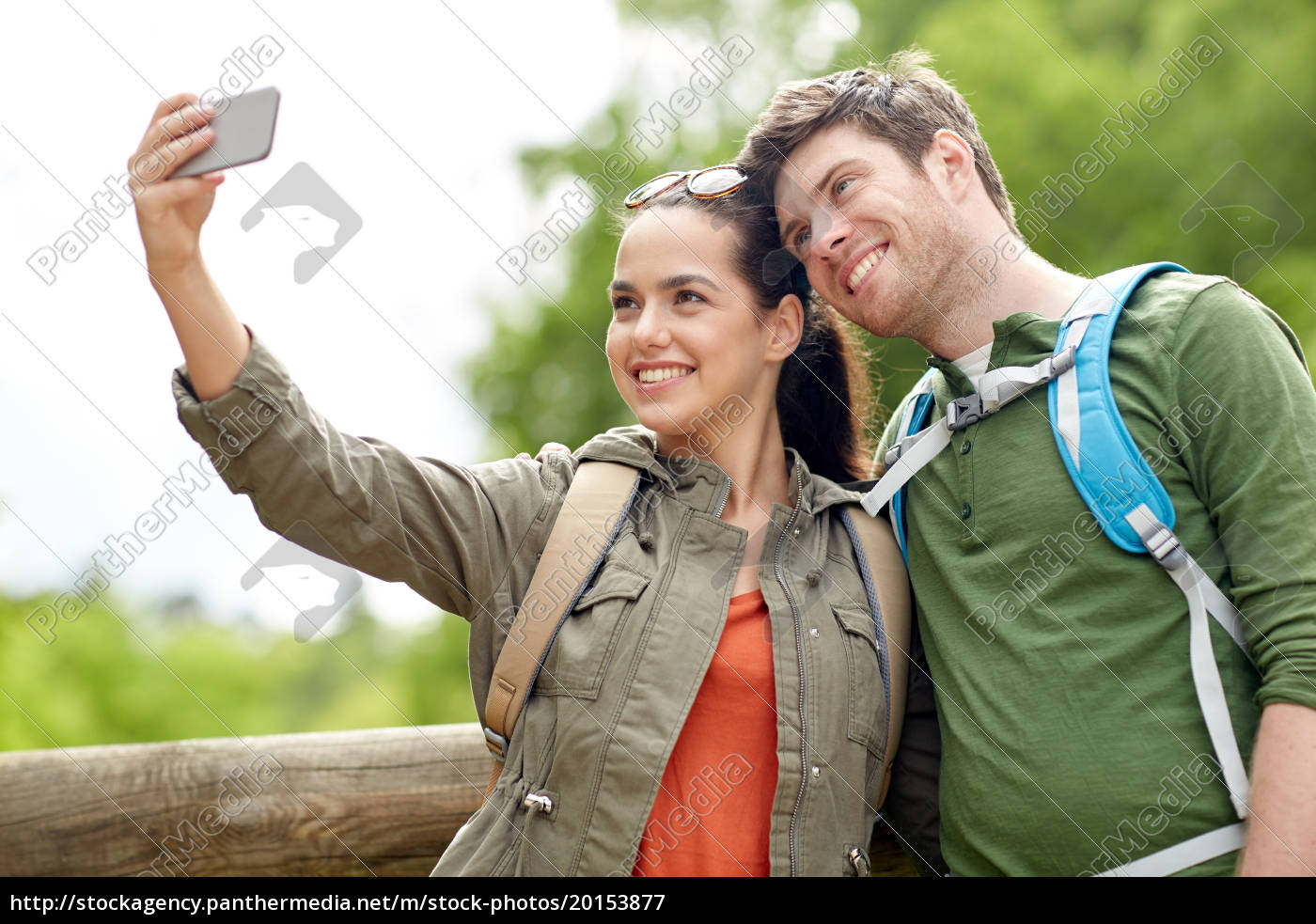 couple, with, backpacks, taking, selfie, by - 20153877