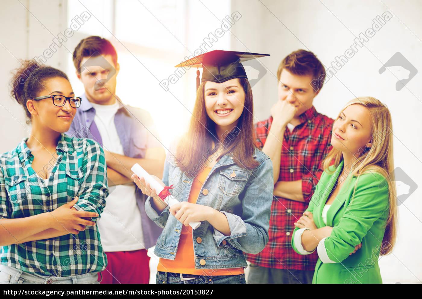 girl, in, graduation, cap, with, certificate - 20153827