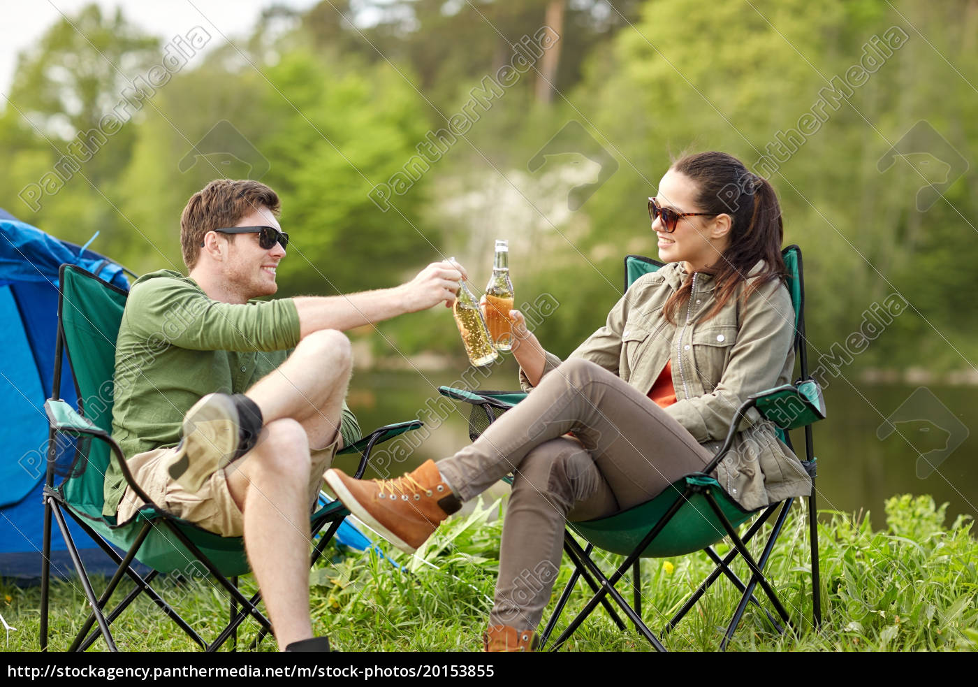 happy, couple, clinking, drinks, at, campsite - 20153855