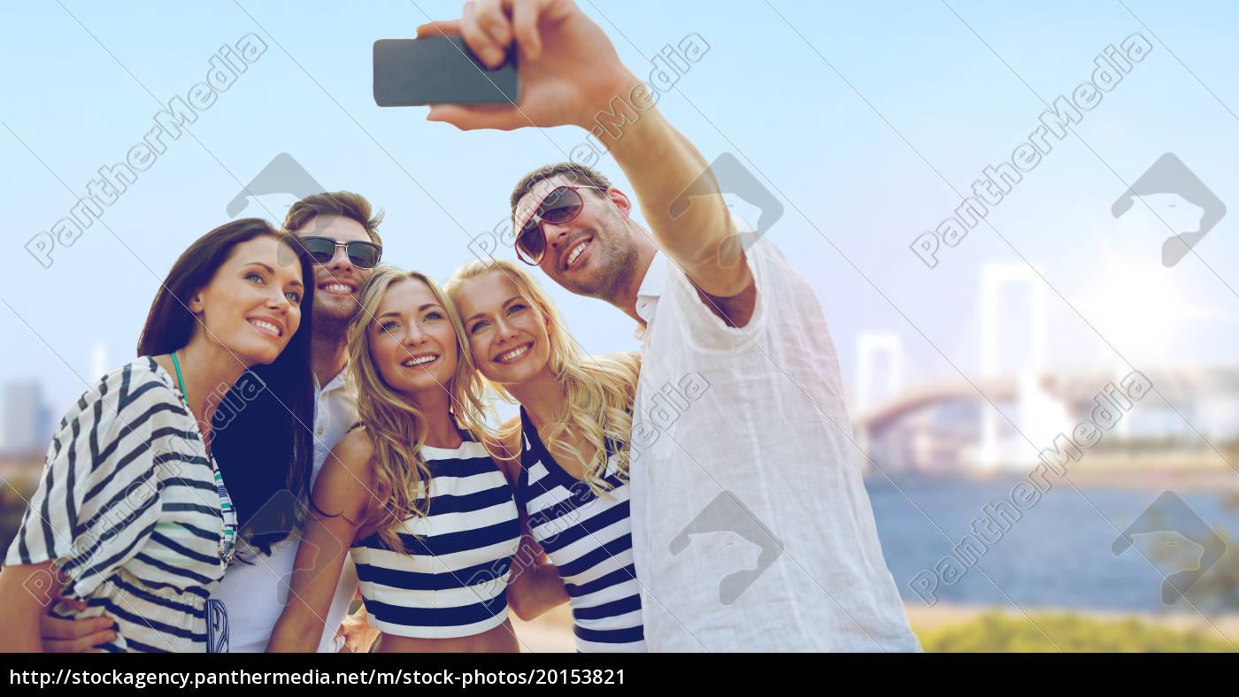 happy, friends, taking, selfie, by, smartphone - 20153821