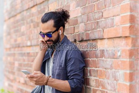 man, with, earphones, and, smartphone, listening - 20153829