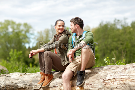 smiling, couple, with, backpacks, in, nature - 20153901