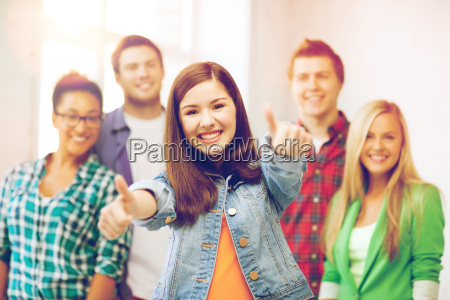 students, showing, thumbs, up, at, school - 20153841