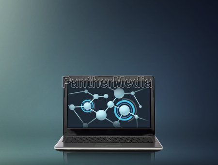 laptop computer with molecules structure on