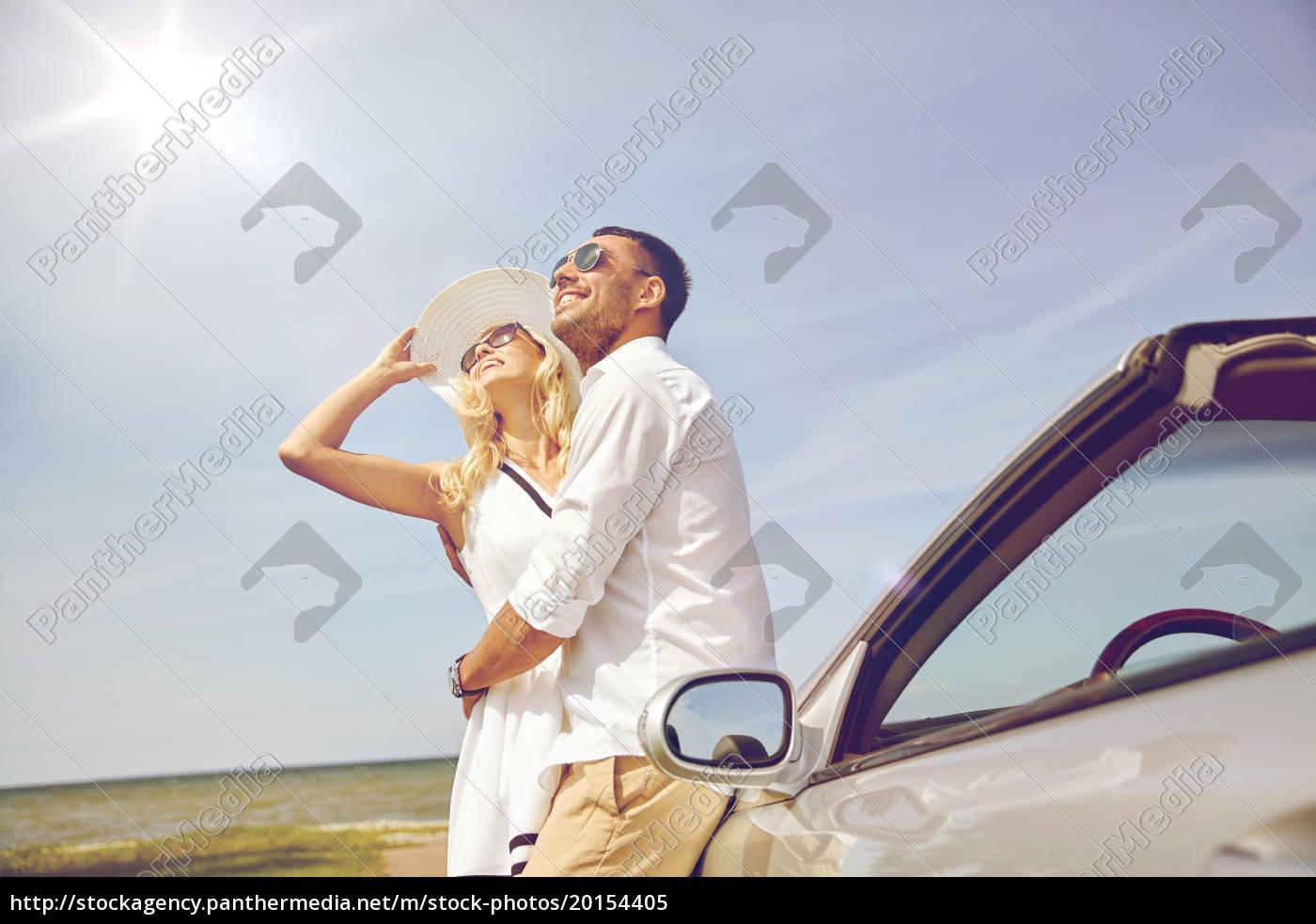 happy, couple, hugging, near, cabriolet, car - 20154405
