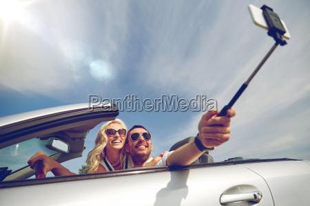 happy, couple, in, car, taking, selfie - 20154421