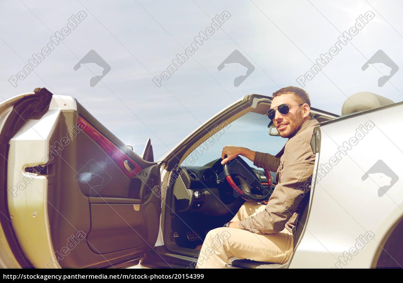 happy, man, opening, door, of, cabriolet - 20154399