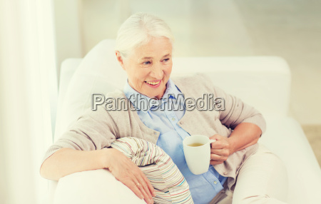 happy, senior, woman, with, cup, of - 20154663